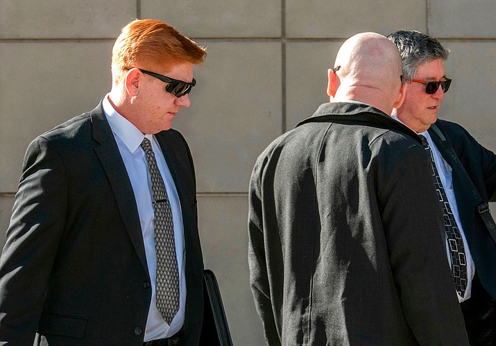 In this March 21, 2018, file photo, Border Patrol agent Lonnie Swartz, left, makes his way to the U.S. District Court building in downtown Tucson, Ariz., where opening arguments were scheduled to begin in his murder trial. A mistrial was declared Monday, April 23, in the case of Swartz after an Arizona jury acquitted him of a second-degree murder charge in the killing of a teen from Mexico but deadlocked on lesser counts of manslaughter. (Ron Medvescek/Arizona Daily Star via AP, File)