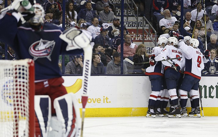 Washington Capitals players celebrate their goal against the Columbus Blue Jackets during the third period of Game 6 of an NHL first-round hockey playoff series Monday, April 23, 2018, in Columbus, Ohio. The Capitals defeated the Blue Jackets 6-3. (Jay LaPrete/AP)