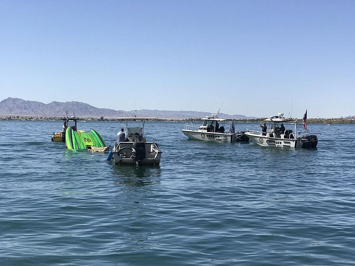 Crews retrieve the wreckage of the Lickity Split, a high-performance racing boat that crashed on Saturday, April 21, 2018, killing two passengers and putting another in critical condition at Havasu Regional Medical Center. The crash occurred following the Desert Storm Shootout on Lake Havasu near the Arizona-California border. (Mohave County Sheriff's Office)
