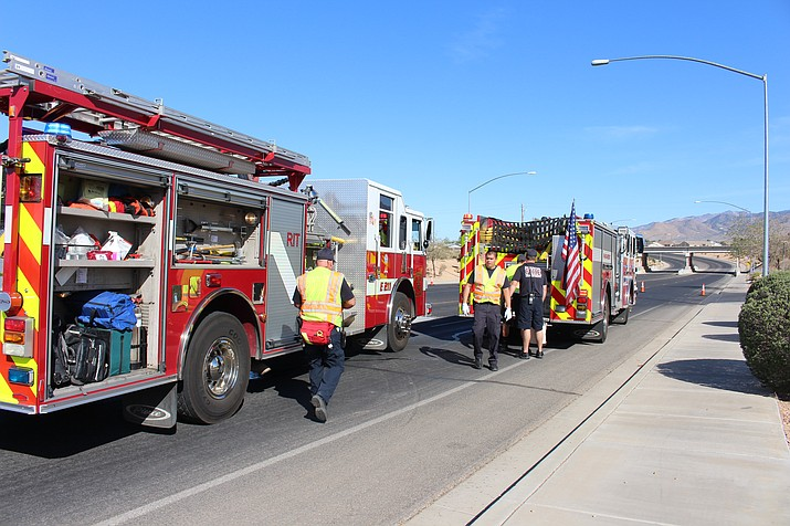 Kingman Fire officials pack up their gear after tending to Saturday's fatal motorcycle crash at Andy Devine and Airway avenues.