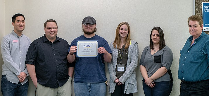 From left: PTK Adviser John Hansen, PTK Historian Joshua Edwards, PTK Vice President of Membership Jason Picard, PTK President Victoria Nowicki, PTK Communications Ariel Adamian and PTK Adviser John Kitts.