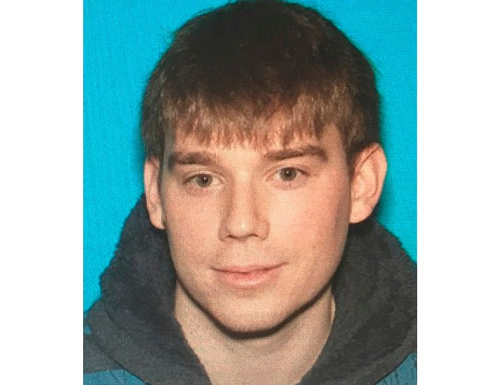 This photo provided by Metro Nashville Police Department shows Travis Reinking, who police arrested in connection with a fatal shooting at a Waffle House restaurant in the Antioch neighborhood of Nashville early Sunday, April 22, 2018. (Metro Nashville Police Department)
