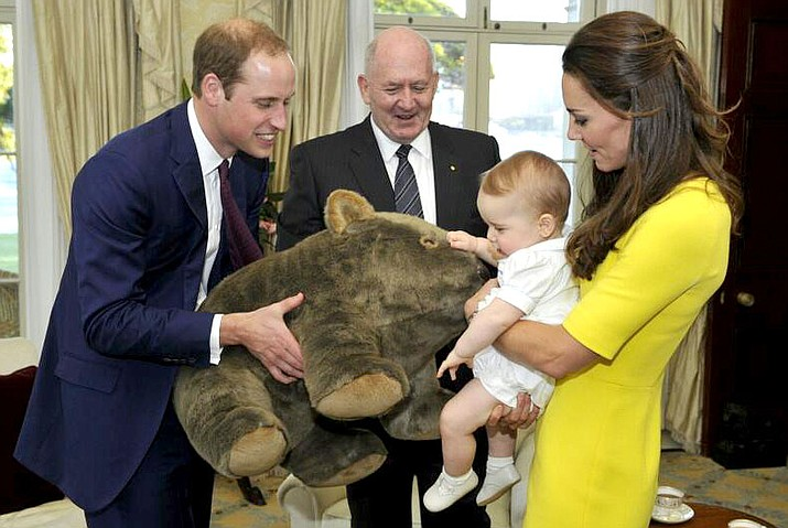 His Royal Highness Prince George of Cambridge, with his parents Their Royal Highnesses The Duke and Duchess of Cambridge, receives a gift from the Governor-General at Admiralty House, Sydney in this 2014 photo. Prince George is now four years old, and his second younger sibling was born Monday.