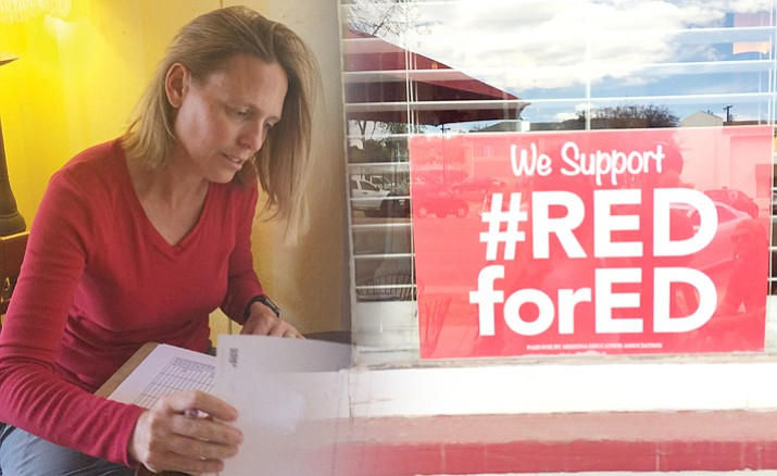 "Taylor Hicks Elementary School second-grade teacher Carrie Farnsworth in Prescott grades papers at Cuppers Coffeehouse on North Cortez Street, as part of the #RedForEd ""Grade Ins"" at education-friendly coffee shops. She is grading math papers. (Nanci Hutson/Courier)"