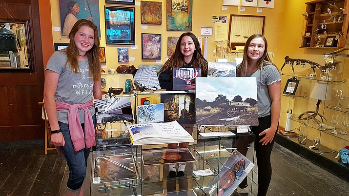Kallison Brinkworth, Cayla Fritsinger and Chanel Perkins display their photography at The Gallery in Williams April 14. The artists were part of the Identity through Art project sponsored by Williams Alliance for the Arts.