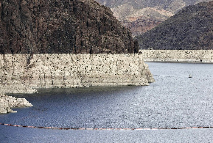 "A 2013 photo shows the ""bathtub ring,"" a high water mark on Lake Mead near Boulder City, Nevada. Tension among U.S. states that rely on the Colorado River escalated into a public feud when an Arizona water provider was accused of manipulating the level of Lake Mead amid a prolonged drought. (AP Photo/Julie Jacobson, File)"