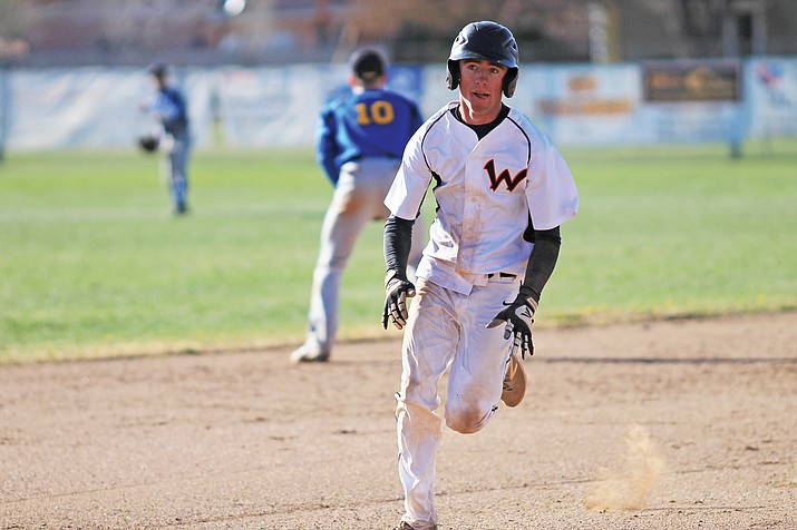 Viking Michael McNelly heads to third base during the game with Ash Fork April 19.