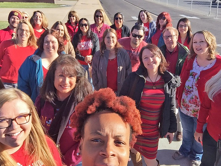 Teachers and staff from Williams Unified School District wear red and during a walk-in April 18 to raise awareness for the need for more school funding. (Submitted photo)