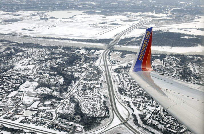 In this Jan. 8, 2014, photo, file a Southwest Airlines plane approaches Lambert–St. Louis International Airport in St. Louis. Over the years, the Dallas-based carrier has paid millions of dollars to settle safety violations, including multiple fines for flying planes that didn't have required repairs. (AP Photo/Kiichiro Sato, File)