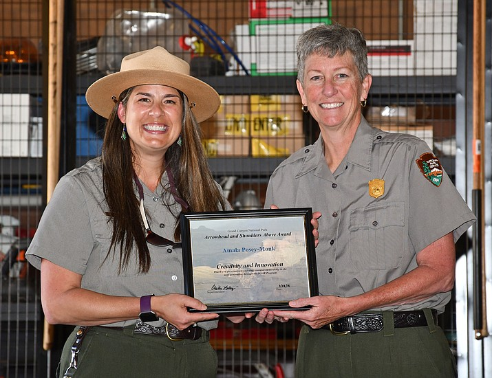 Amala Posey-Monk receives the Arrowhead and Shoulders Above Award for Innovation and Creativity from Grand Canyon Superintendent Chris Lehnertz. (Mike Quinn/NPS)