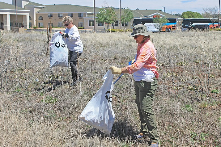 Participants pick-up garbage during a Williams Clean and Beautiful event in 2017.  The city is hosting a clean-up day May 4.