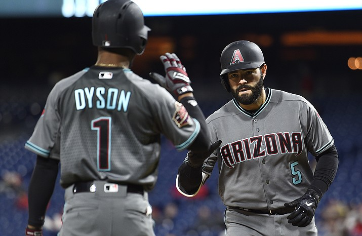 Arizona Diamondbacks' Alex Avila, right, high fives Jarrod Dyson after Avila hit a solo home run off Philadelphia Phillies' Vince Velasquez during the third inning Tuesday, April 24, 2018, in Philadelphia. Derik Hamilton/AP)