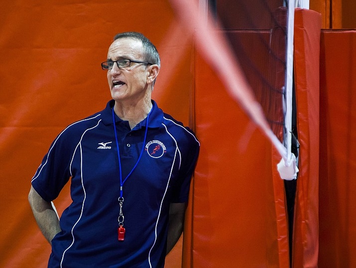 In this Aug. 4, 2014, photo, Rick Butler, a nationally renowned volleyball coach from Chicago, watches a scrimmage during the first day of a volleyball camp at Abbott Sports Complex in Lincoln, Neb. Michigan State University has maintained ties to Butler for decades after he was publicly accused in 1995 of sexually abusing and raping six underage girls he trained in the 1980s. Letters obtained by The Associated Press from accusers' advocates show the school has been under pressure since at least 2017 to sever ties with Butler. (Stacie Scott/Lincoln Journal Star, via AP)