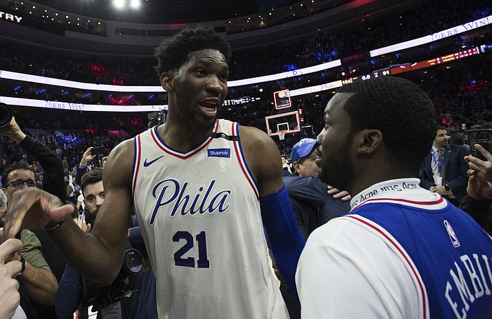Philadelphia 76ers' Joel Embiid, left, of Cameroon, talks with Rapper Meek Mill, right, during the second half in Game 5 of a first-round NBA basketball playoff series against the Miami Heat, Tuesday, April 24, 2018, in Philadelphia. The 76ers won 104-91. (Chris Szagola/AP)