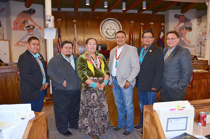 "From left: Navajo Nation Council Delegates Otto Tso, vice chair Jonathan Perry, chair Amber Crotty, Jonathan Hale, Steven Begay and Dwight Witherspoon at the Navajo Nation Council Chambers seeking to enact the Revenge Porn Act. Hale worked with members from Naabik'íyáti' Sexual Assault Prevention Subcommittee to develop policy to combat revenge porn defined as ""sexually explicit images of a person posted online without that person's consent, especially as a form of revenge of harassment."" (Navajo Nation Council)"