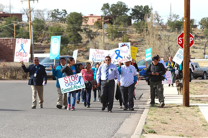 Navajo Nation Speaker LoRenzo Bates and participants walk to the Council Chamber to raise awareness for sexual assault prevention April 16 in Window Rock. (Navajo Nation Council)
