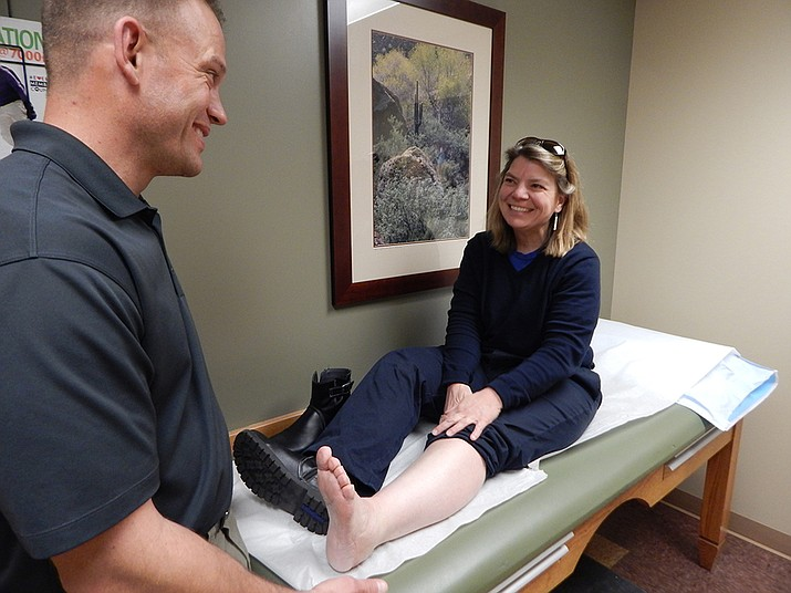 Dr. Brandon Clark and Jean Balestrery during a recent examination after a traumatic injury was sustained by Balestrery during a visit to Havasu Falls in the Grand Canyon last summer. Clark and Balestrery  said they are very pleased with the healing process. (Photo/Northern Arizona Orthopedics)