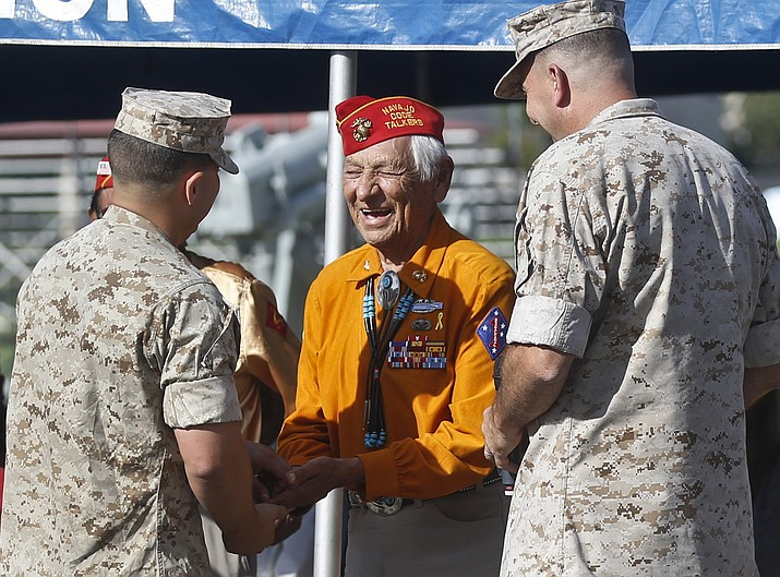 In this Sept. 28, 2015, file photo, former United States Marine and Navajo Code Talker Roy Hawthorne Sr., center, talks with Marines including Major Gen. Daniel O'Donohue, right, at a ceremony honoring the code talkers and their contributions to the U.S. war effort in World War II, at Camp Pendleton, California. The Navajo Nation says Hawthorne Sr. died April 21. He was 92. Hawthorne enlisted in the U.S. Marine Corps at age 17 and became part of a famed group of Navajos who transmitted hundreds of messages in their language without error. The code was never broken. (AP Photo/Lenny Ignelzi, File)