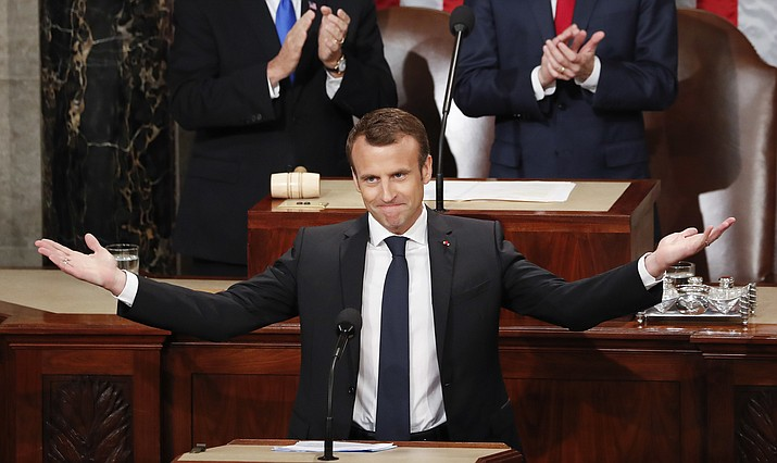 French President Emmanuel Macron gestures as he is introduced before speaking to a joint meeting of Congress on Capitol Hill in Washington, Wednesday, April 25, 2018.(AP Photo/Pablo Martinez Monsivais)
