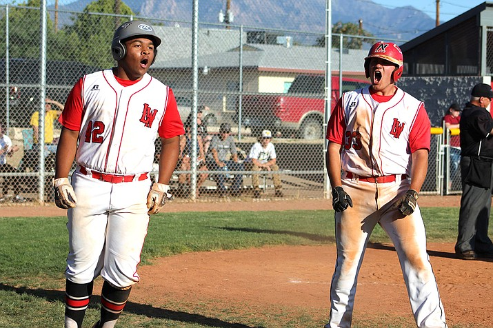 Lee Williams' Addis Guzman, left, and Matt Bathauer celebrate Wednesday during a 4A State Tournament play-in game against Walden Grove at Dick Grounds Field.