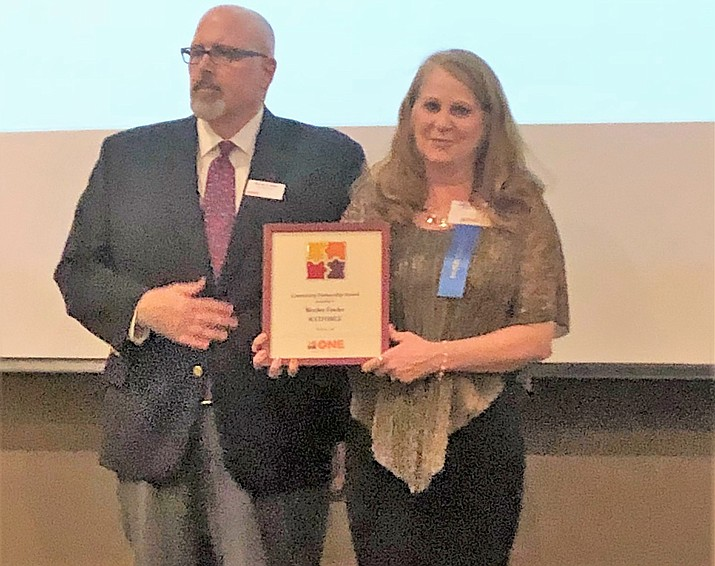 Merilee Fowler, right, executive director of MatForce, is honored March 29 as the Arizona outstanding Director of the Year for Community Partnerships. The award was presented at a luncheon in Phoenix by ONE, the Organization for Nonprofit Executives. (Courtesy)