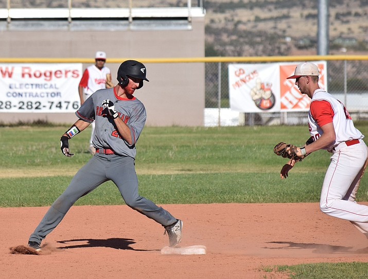 Bradshaw Mountain Paxton Prentice (22) gets into second base after recording a two-RBI single against Mingus on Wednesday, April 25, 2018, in Cottonwood. (James Kelley/Independent)