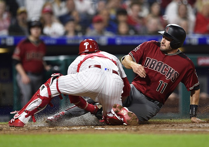 Arizona Diamondbacks' A.J. Pollock, right, is tagged out at home plate by Philadelphia Phillies' Andrew Knapp after Jarrod Dyson hit a fielders choice during the fourth inning of a baseball game, Wednesday, April 25, 2018, in Philadelphia. (Derik Hamilton/AP)