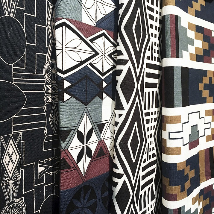 Fabric design by a Romanian design brand, Halfdrop, used in products for interiors. Romanian architect and designer Alexandra Lazarescu interprets her country's folk heritage and imagery in geometric patterns with contemporary sophistication. (HALFDROP via AP)