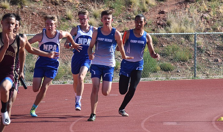 Camp Verde freshman Noah Zimmermann receives the baton from junior Christopher Holdgrafer during the 4x100 relay at the Red Rock Invitational Last Chance in Sedona on Tuesday. The Cowboys finished fourth. (VVN/James Kelley)