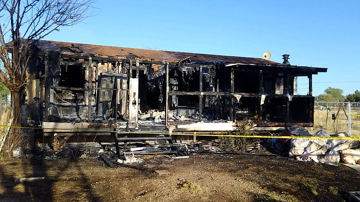The burnt remains of a manufactured home in Dewey that experienced a fire early Thursday morning, April 26.