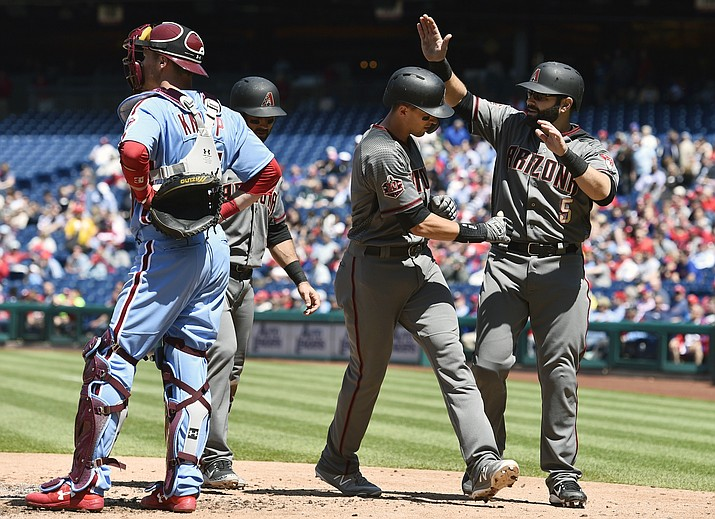 Arizona Diamondbacks' Nick Ahmed, second from right, is congratulated by Alex Avila, right, after Ahmed hit a three-run home run off Philadelphia Phillies' Ben Lively during the third inning of a baseball game, Thursday, April 26, 2018, in Philadelphia. (Derik Hamilton/AP)