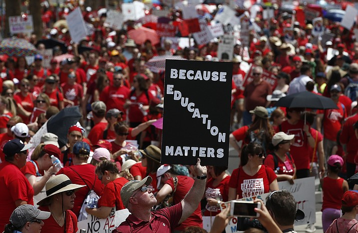 Thousands march to the Arizona Capitol for higher teacher pay and school funding Thursday in Phoenix. (Ross D. Franklin/AP)