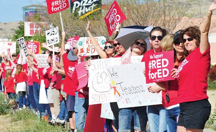 Humboldt Unified School District teachers gather along Highway 69 in Prescott Valley as teachers across Arizona stage a walkout, forcing school closures, seeking more pay and restored funding for education Thursday, April 26, 2018. (Les Stukenberg/Courier)