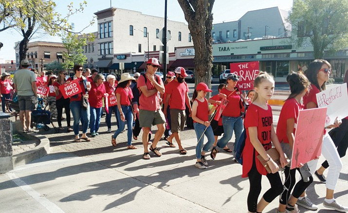 People from all walks of life converged on the courthouse plaza in Prescott Thursday morning, April 26, 2018, to show their support for education. There were teachers, students, retirees, families and even pets wearing red. (Brenda Brown/Courier)