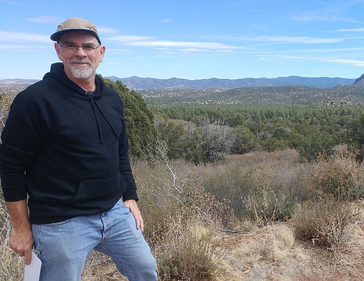 Brent Roberts of Prescott Mountain Bike Association, or PMBA, stands near a trailhead by Spence Basin off Iron Springs Road where PMBA is looking to expand trail offerings to mountain bikers. (Doug Cook/Courier)