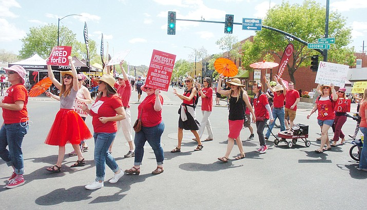 Prescott Unified School District teachers and supporters march across Montezuma Street as part of the #RedforEd movement Friday, April 27, 2018. Students won't have classes on Monday due to previously scheduled professional development day. (Les Stukenberg/Courier)
