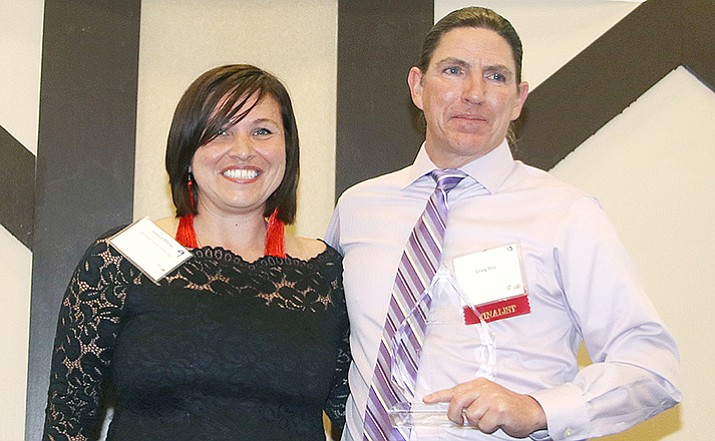 Craig Mai, Mingus Union High math teacher, is congratulated as the 2018 Teacher of the Year by 2017 honoree Jessica Marks at the  Yavapai County Education Foundation banquet Friday, April 27, at the Prescott Resort. (Matt Santos/Courtesy)