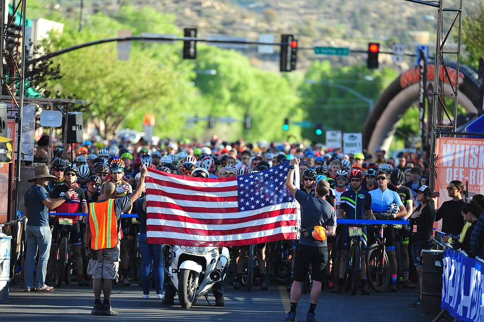 The National Anthem is sung before the Whiskey Off Road 30 and 50 mile amateur races in Prescott Saturday, April 28, 2018. (Les Stukenberg/Courier)