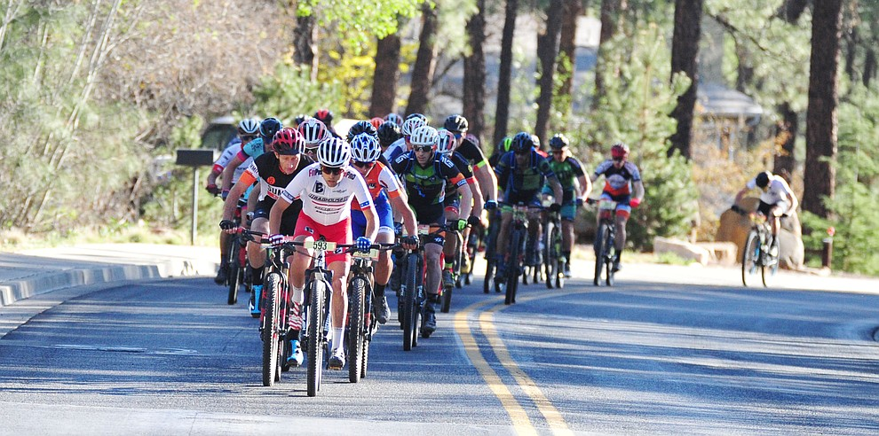 50-milers going uphill on Copper Basin Road during the Whiskey Off Road 30 and 50 mile amateur races in Prescott Saturday, April 28, 2018. (Les Stukenberg/Courier)