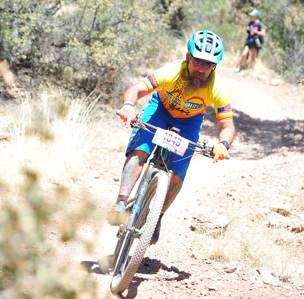 Benjamin Chandler on course during the Whiskey Off Road 30 and 50 mile amateur races in Prescott Saturday, April 28, 2018. (Les Stukenberg/Courier)