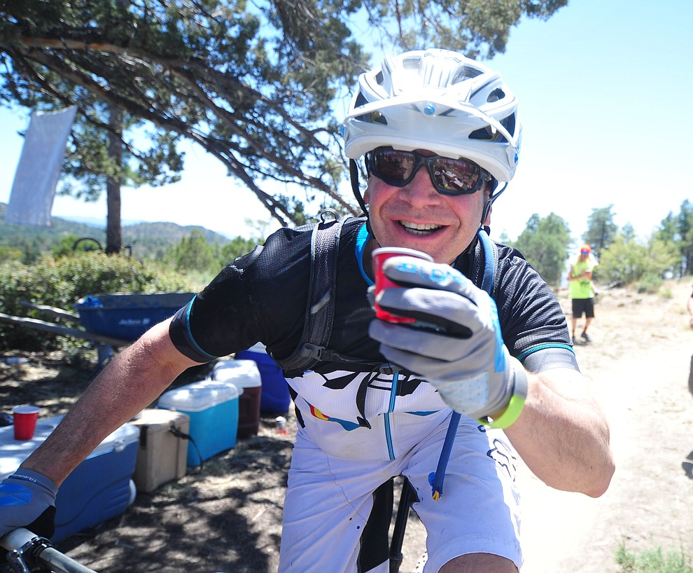 A rider enjoys a shot of whiskey during the Whiskey Off Road 30 and 50 mile amateur races in Prescott Saturday, April 28, 2018. (Les Stukenberg/Courier)