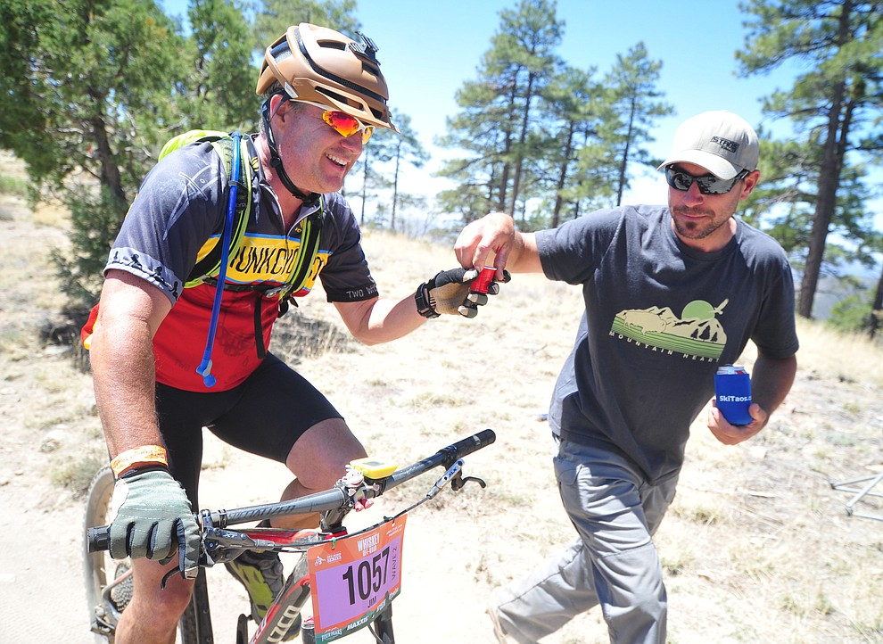 James Talerico gets a shot of whiskey during the Whiskey Off Road 30 and 50 mile amateur races in Prescott Saturday, April 28, 2018. (Les Stukenberg/Courier)