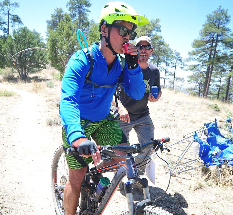 A rider takes a shot of whiskey during the Whiskey Off Road 30 and 50 mile amateur races in Prescott Saturday, April 28, 2018. (Les Stukenberg/Courier)