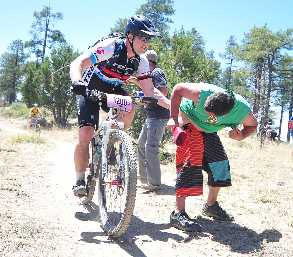 Cody Teeples gets a slap in during the Whiskey Off Road 30 and 50 mile amateur races in Prescott Saturday, April 28, 2018. (Les Stukenberg/Courier)