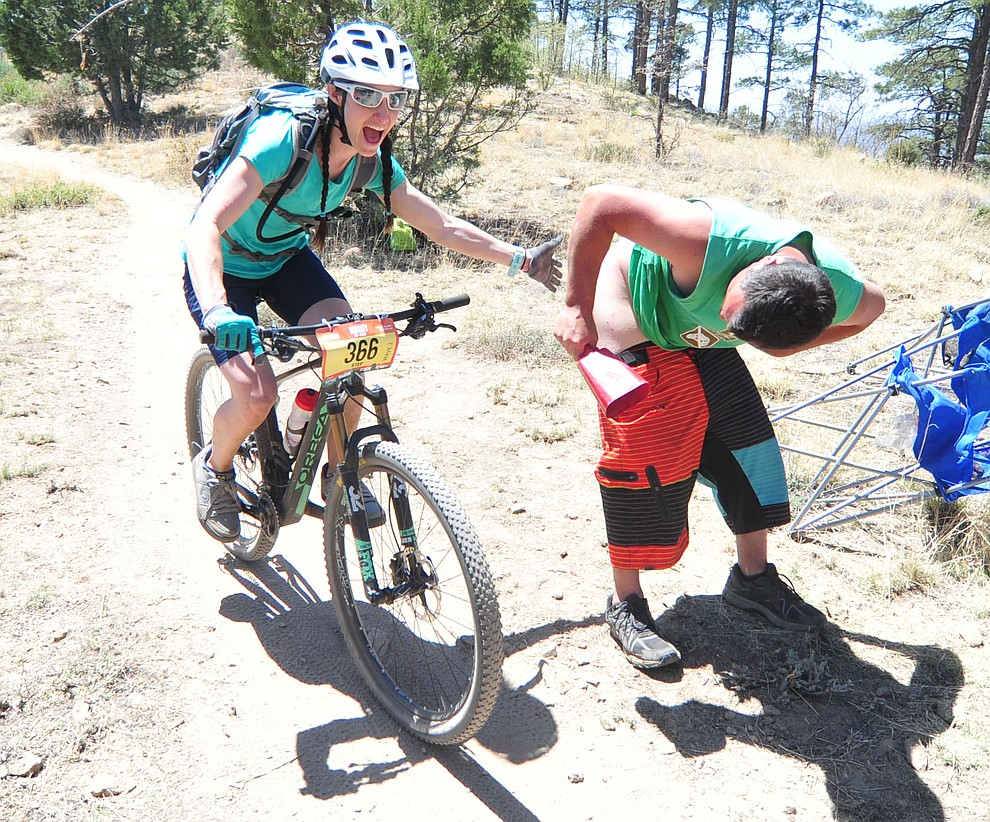 Stefanie Peterson enjoys giving a smack during the Whiskey Off Road 30 and 50 mile amateur races in Prescott Saturday, April 28, 2018. (Les Stukenberg/Courier)