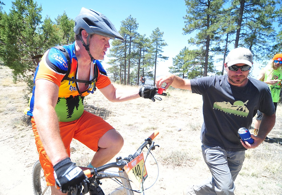 Jamie Seegert takes his shot of whiskey during the Whiskey Off Road 30 and 50 mile amateur races in Prescott Saturday, April 28, 2018. (Les Stukenberg/Courier)