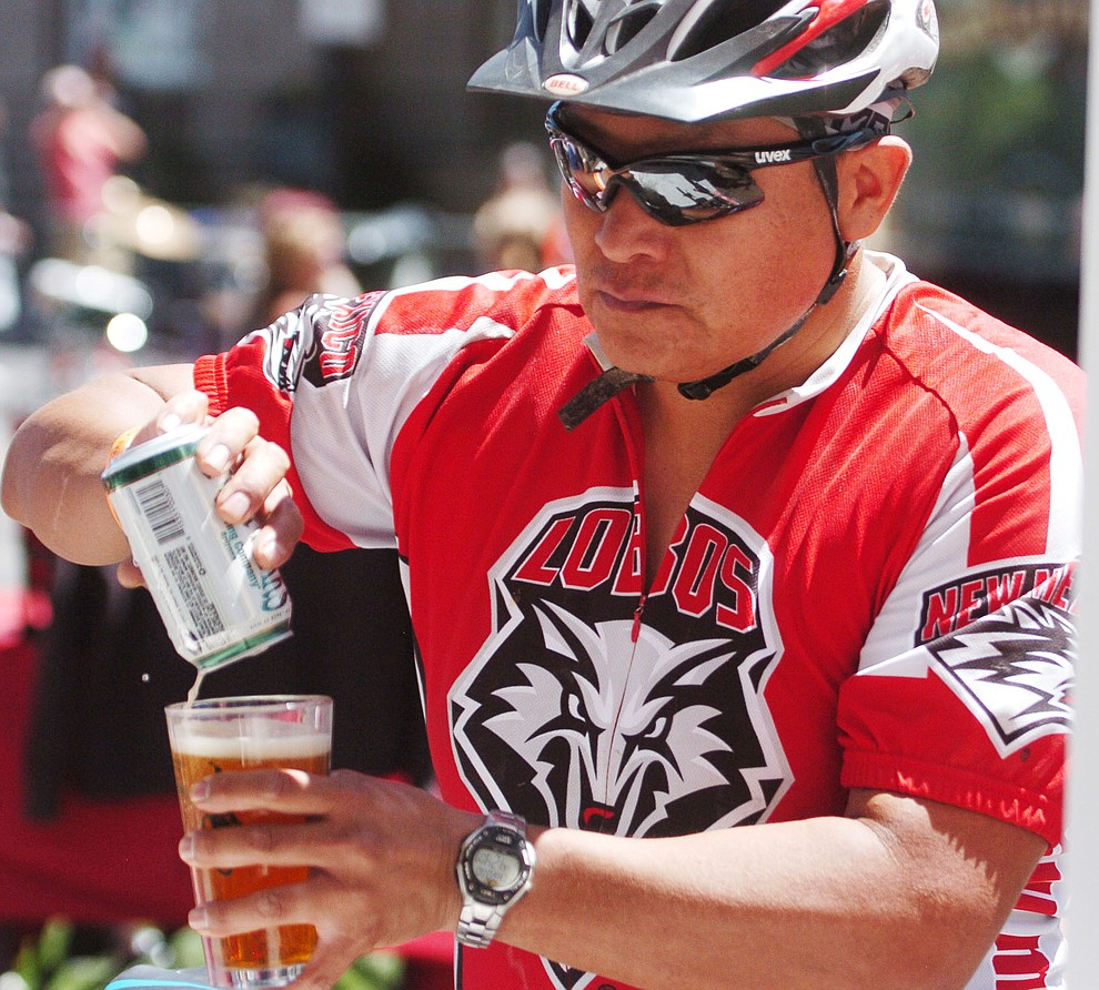 Hans Aspaas enjoys a post race beerfollowing the Whiskey Off Road 30 and 50 mile amateur races in Prescott Saturday, April 28, 2018. (Les Stukenberg/Courier)
