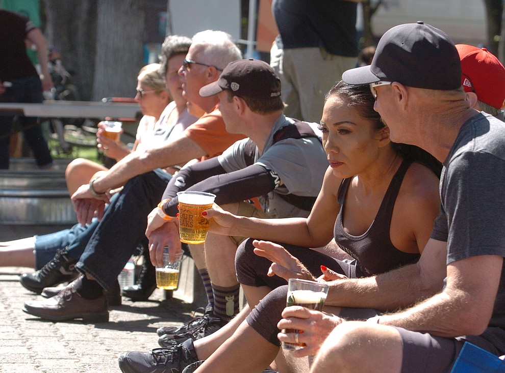 Enjoying a beverage and listening to music following the Whiskey Off Road 30 and 50 mile amateur races in Prescott Saturday, April 28, 2018. (Les Stukenberg/Courier)
