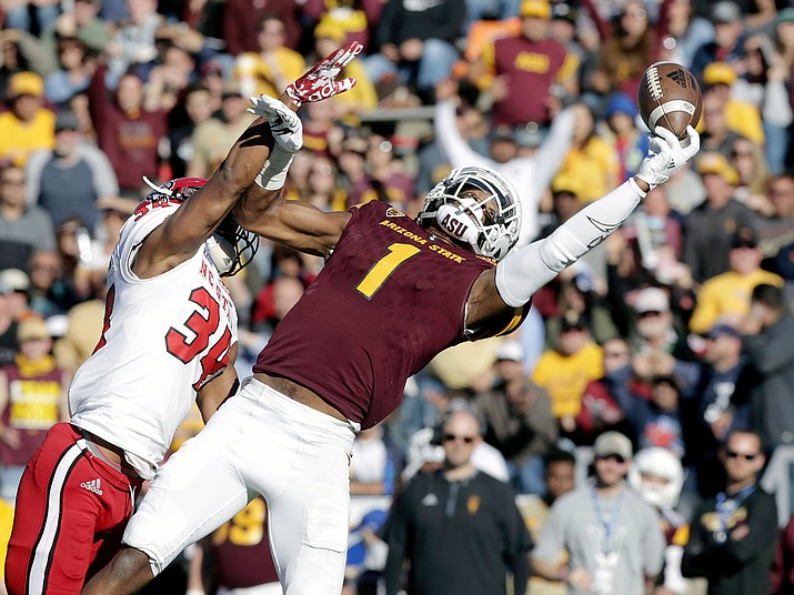 Arizona State wide receiver N'Keal Harry, right, in this Dec. 29, 2017, file photo, makes a juggling catch while holding off North Carolina State's Tim Kidd-Glass during the Sun Bowl NCAA college football game in El Paso, Texas. Harry had a superb freshman season and followed it up with an even better sophomore year, leading the Sun Devils with 82 receptions, 1,142 yards and eight TDs. An athletic 6-foot-4, Harry could have an even bigger second season in the desert before a potential leap to the NFL. (Mark Lambie/The El Paso Times via AP, File)