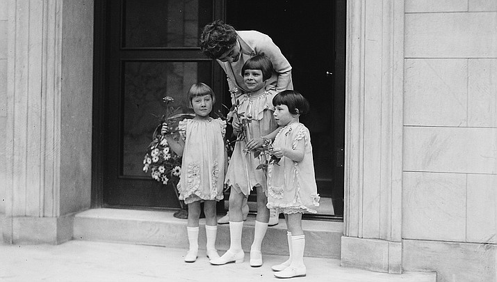 In this 1927 photo children surprise First Lady Grace Coolidge with a May Day basket of flowers. (Library of Congress)